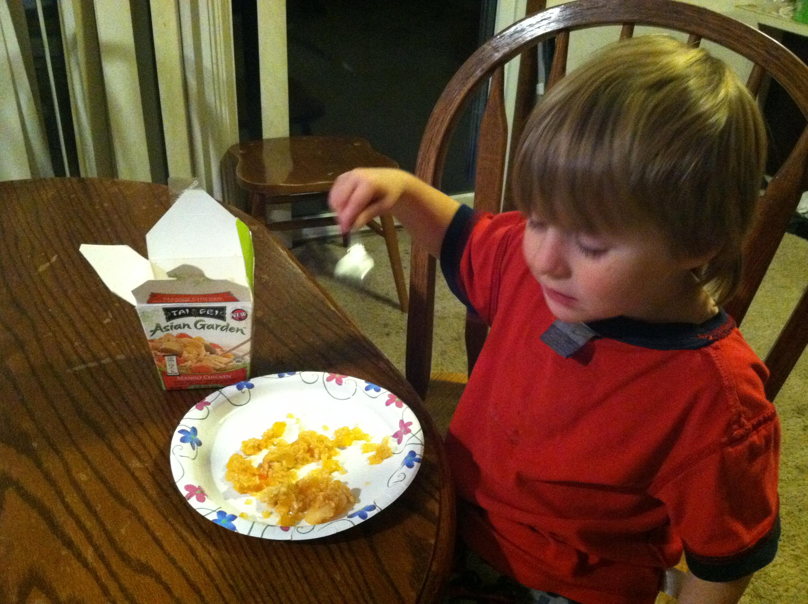 Jr eating Tai Pei Mango Chicken